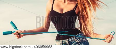 Girl With Perfect Waist With A Jump Rope In Hands. Fit Fitness Girl Measuring Her Waistline With Mea