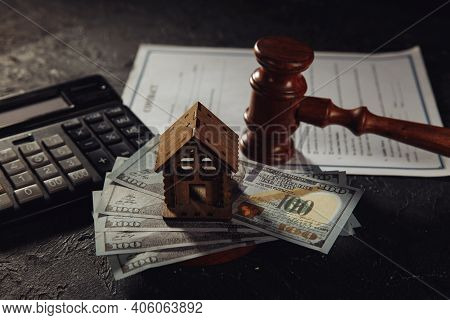 House Keys With Money And Wooden Hammer