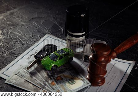 Wooden Judge Gavel And Green Toy Car With Keys. Symbol Of Law, Justice And Car Auction