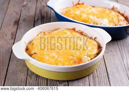 Potato Gratin, Gratin Dauphinois On Wooden Table, French Cuisine