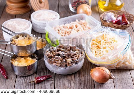 Frozen Food. Frozen Casserole. Mushroom, Chicken And Cheese Gratin In Bowls On Wooden Table