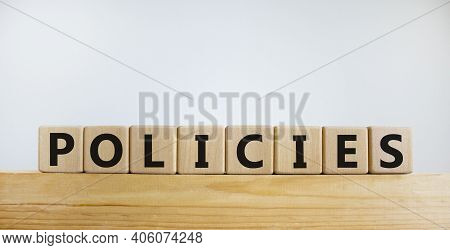 Policies Symbol. Concept Word 'policies' On Wooden Cubes On A Beautiful White Background. Copy Space