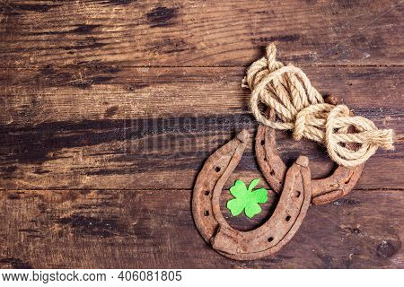 Badly Worn Horseshoes, Rope, And Felt Clover Leaf