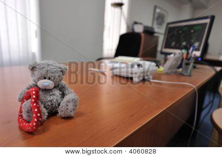Office Desk With A Teddy Bear