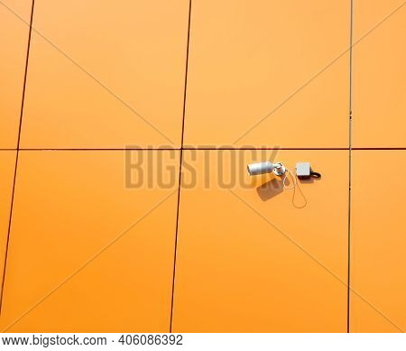 Security Camera Mounted On Modern Building Wall Finished With Orange Panels  Horizontal View Close U