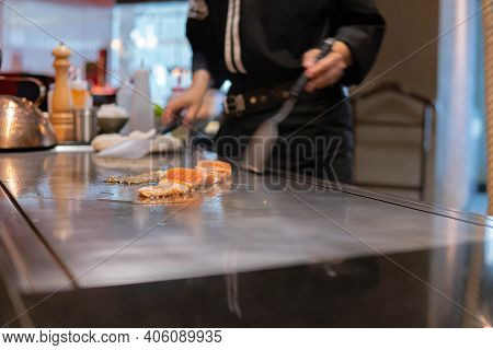 Hand Of Chef Cooking Salmon Steak