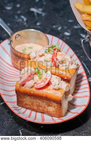 Lobster Roll.fresh Maine Lobster Boiled, Mixed With Mayo, Celery, Chives Served In Toasted Hero Roll