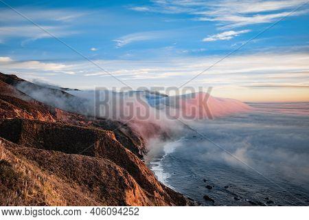 Scenic View Of Ocean Shore Near Big Sur, California, Usa. Cloud Covered Coast, Sea And Cliff Hills.
