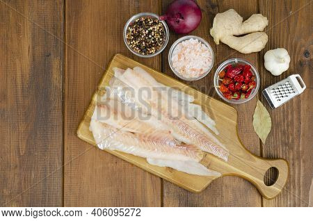 Frozen Pollock Fillet. Cooking Fish Dishes. Studio Photo