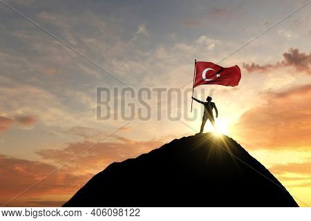 Turkey Flag Being Waved At The Top Of A Mountain Summit. 3d Rendering