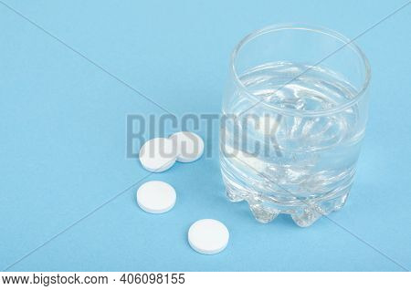 White Round Tablets, Soluble In Glass Of Water. Studio Photo