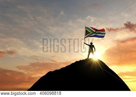 South Africa Flag Being Waved At The Top Of A Mountain Summit. 3d Rendering