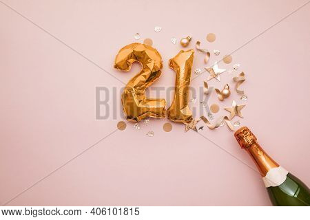 Happy 21st Anniversary Party. Champagne Bottle With Gold Number Balloon.
