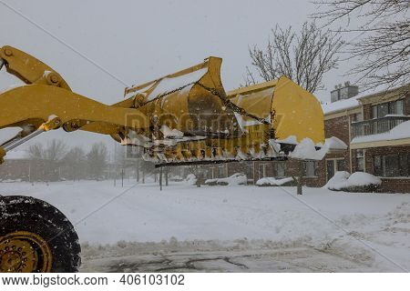 Snow Clearing Tractor Clears The Way After Heavy Snowfall For Vehicle Access