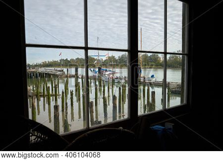 Britannia Shipyards Heritage Dock. Dock view through a window of the historic Brittania Heritage shipyard on the banks of the Fraser River in Steveston, British Columbia, Canada.