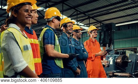 Skillful Worker Attending Brief Meeting In The Factory . Industrial People And Manufacturing Labor C