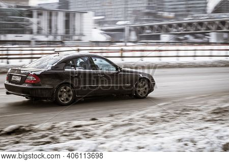 Moscow, Russia - January 15, 2021: Old Black Mercedes W211 On Snowy Winter Road In City. Mercedes-be