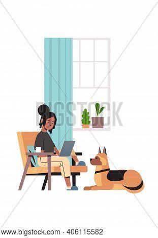 African American Woman Freelancer Using Laptop Working At Home During Coronavirus Quarantine Self-is