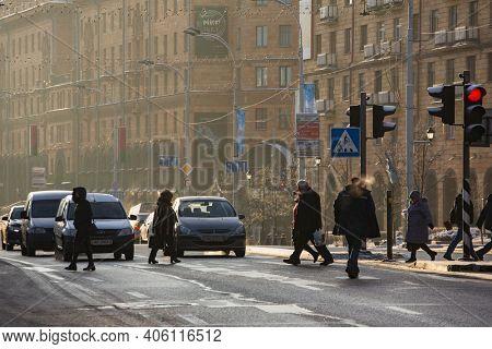 Minsk, Belarus - January 24, 2018: Unidentified people crossing street in central part of Minsk in winter
