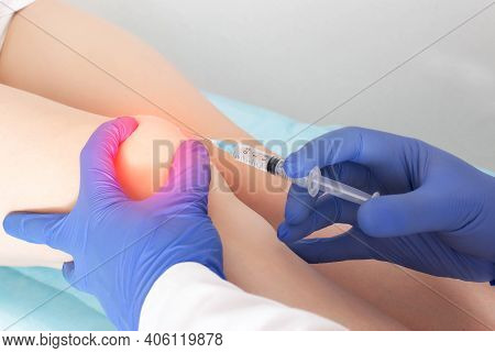 The Doctor Injects Injections With Hyaluronic Acid Into The Knee Joint Of A Patient Who Has Pain And