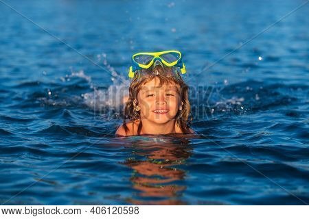 Summer Child. Funny Child On Beach. Boy Swim In Sea On Summer Holidays. Happy Kids Swimming In The W