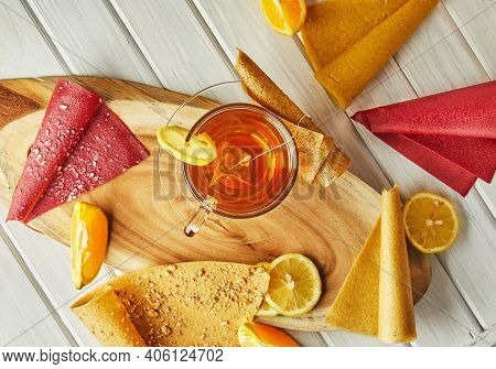 Sweet Pastille Of Pure Fruits In Rolls With Citrus Fruits And Tea With Lemon. Healthy Sweets - Lolli
