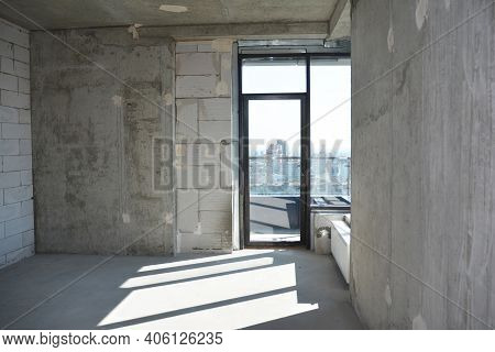 An Inside View Of An Empty Newly Constructed Apartment, Flat Without Repair With A Window Installed