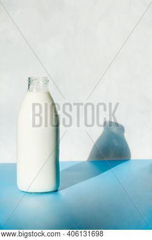 Milk Bottle In Pop Art Style On A Blue Background. Minimalism, Vertical Orientation