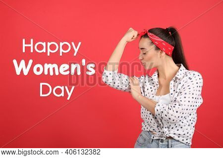 Strong Woman As Symbol Of Girl Power On Red Background. Happy Women's Day