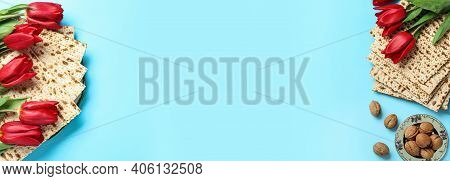 Matzos And Flowers On Light Blue Background, Flat Lay With Space For Text. Passover (pesach) Seder