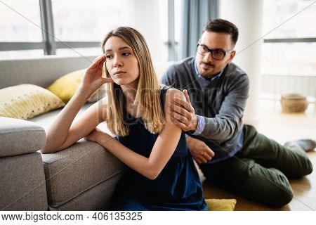 Unhappy Couple Having Argument At Home. Family, Problem, Quarell People Concept.