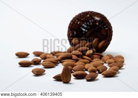 Almonds On A White Background. Isolated Almonds. Roasted Almonds Spilled Out Of The Basket