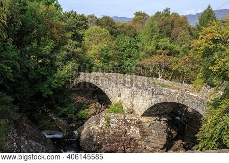Scotland, Great Britain - September 12. 2014: This Is An Old Arched Stone Bridge Over A Mountain Str