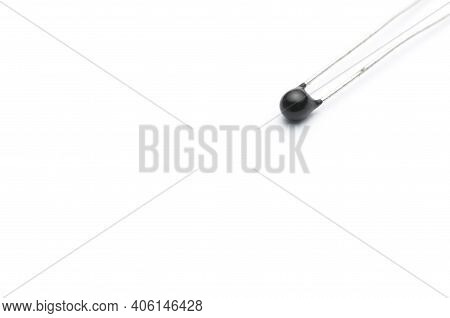 Close-up Shot Of An Electronic Thermistor Isolated On White Background