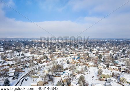 residential area of Fort Collins in northern Colorado, aerial view of winter scenery with fresh snow