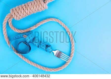 Diet, Anorexia, Weight Loss Concept, Measuring Tape With A Fork On A Blue Background In A Suicide Lo