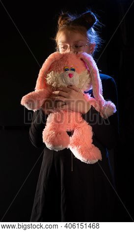 Girl With A Big Plush Hare. Girl Teenager With A Pink Hare. Girl With A Gift.