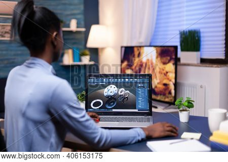 African Freelancer Using Cad To Design A Technical Concept From Home Office In The Evening. Industri