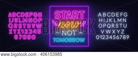 Start Now Not Tomorrow Neon Quote On A Brick Wall.