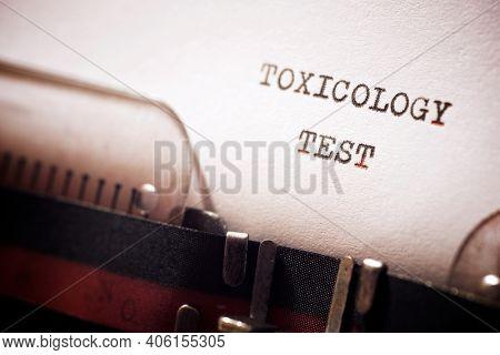 Toxicology test phrase written with a typewriter.