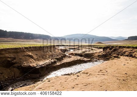 Empty River. Drought Land Texture, Summers Dry, Cracked Soil, Ground On The Field, Blurred Cracked E