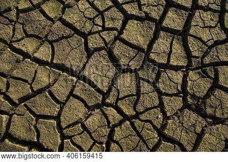 Drought Land Texture, Summers Dry, Cracked Soil, Ground On The Field, Blurred Cracked Earth. Global