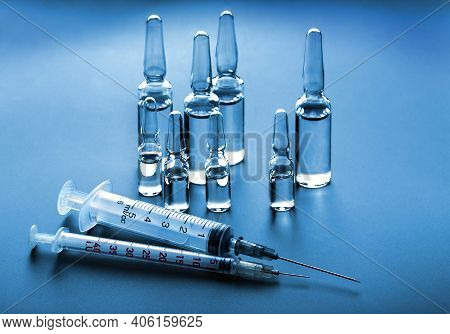 Medical Syringes And Ampules With Vaccine. Stop Coronavirus Pandemic, Covid-19 Vaccination,