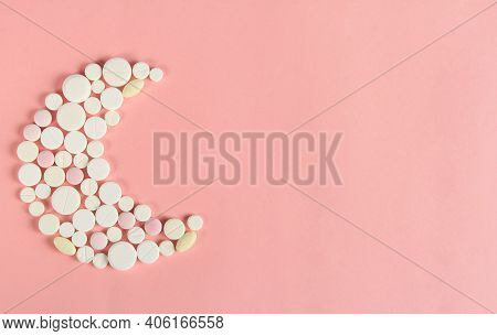 Banner Design For Sleeping Pills And Evening Sedatives In The Shape Of A Moon On A Pink Background.