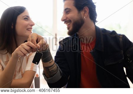 Rental Contract. Transport Purchase. Happy Couple With Car Key. Happy Young Couple Chooses And Buyin