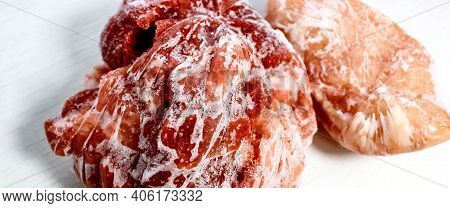 Frozen Raw Meat, Pork And Chicken Fillet, Covered With Frost On A White Background. Frozen Blanks. S