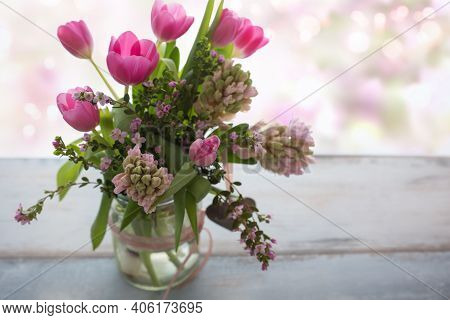 Composition With Fresh Spring Flowers On Gray Wood, In Background Tender Romantic Pink Bokeh With Sp