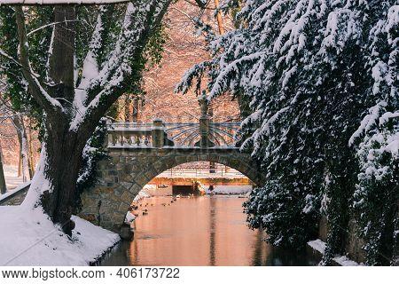 Manor Park In Iłowa In Winter. A Brick Bridge Over The Czerna Mała River.\nthe Town Of Iłowa In West