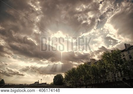 Sky Is Clouding Over. Dramatic Sky On Urban Landscape. Sun Burst Through Clouds. Cloudy Sky In City.