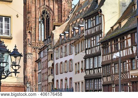 Traditional European Style Half Timbered Frame Houses And Cathedral In Historical City Center Of Str